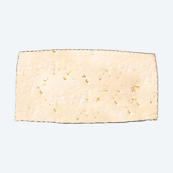 Queso de Leche Cruda de Oveja Viejo Torremilano cortado a la mitad | Quesos COVAP